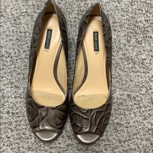 Multi colored heel. Great condition!  Peep toe!